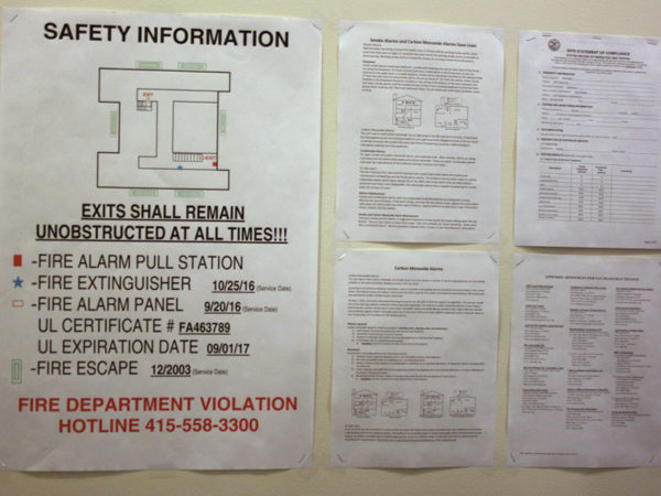 New required safety signage in an apartment building. Photo by Laura Wenus