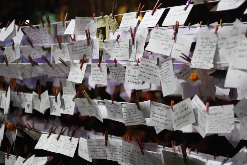 By late evening, notes to departed loved ones had filled the installation.