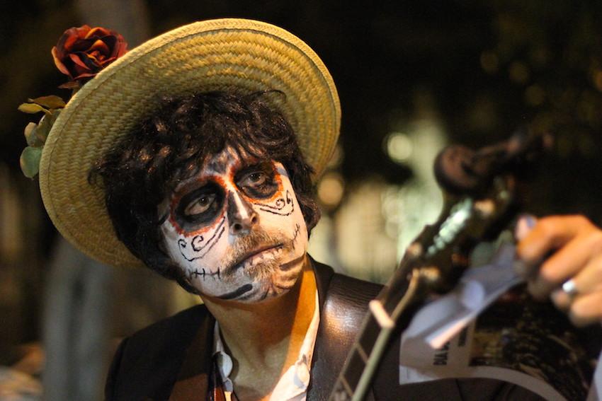 Daren Iguchi - of The Skeleton Crew, AKA Grassiachi, tunes his instrument.