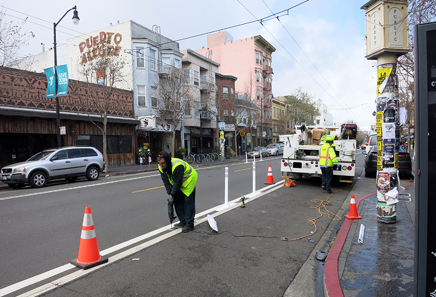 Flex posts go up to protect cyclists on Valencia Street bike lanes