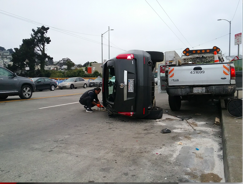 Cadillac SUV collides with Muni bus on Mission and flips — SUV driver allegedly flees scene