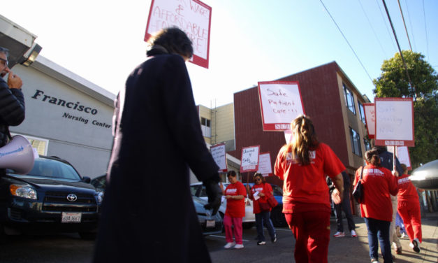 Picketing Outer Mission nursing home workers threaten strike, bemoaning low wages and benefits