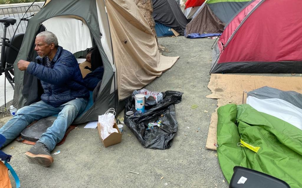 Cops roll into huge Civic Center homeless encampment — residents say they were forced to stay in tents during 'curfew'