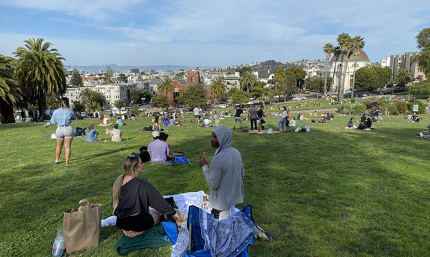 Dolores Park fills up late Friday, as health experts at UCSF town hall warn of the dangers