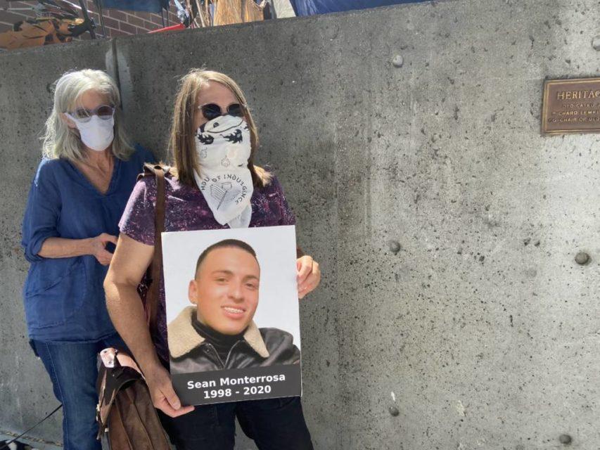 Gretchen Zimmerman holds an image of Sean Monterrosa