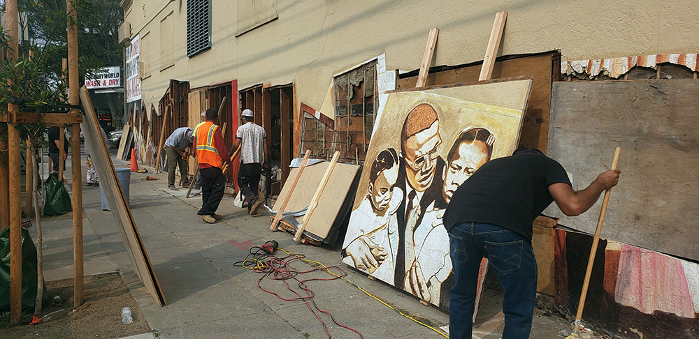 Photos: A historic mural comes down in preserved pieces