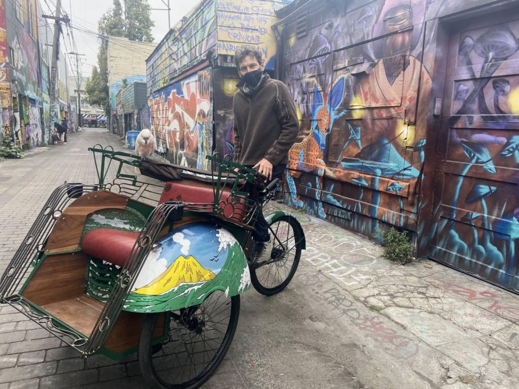 Kai Bansner with his custom-built rickshaw