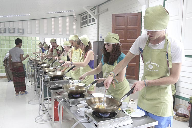 Students cooking in kitchen.