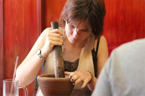 Student with mortar and pestle.