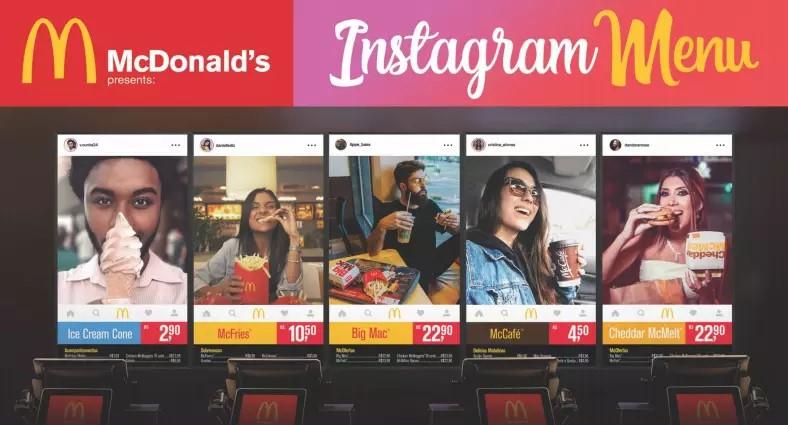influenciadores digitais: imagem do visor digital do mc donalds com fotos dos clientes comendo lanches