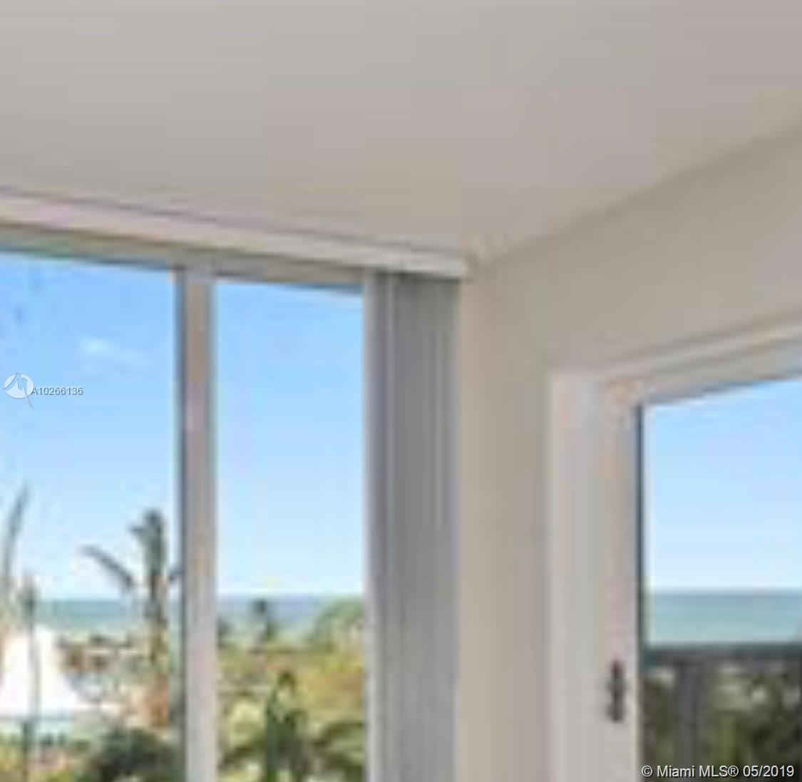 10275 Collins Ave #407.