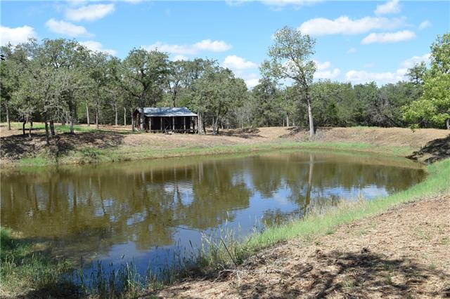 Residence: A small open floor plan cabin overlooking a large tank is located on the Southern section of the ranch. Improvements: Electric & County Water in place, Cattle Pens, sheds, Trees: Cedar Elm and Post Oak thickets are found throughout the ranch. Along Lytton Creek and other natural drainage areas you will find numerous towering Elms and Mature Post Oaks.  Buyer's broker must be identified on first contact, and must accompany buying prospect on first showing to be allowed full fee participation.