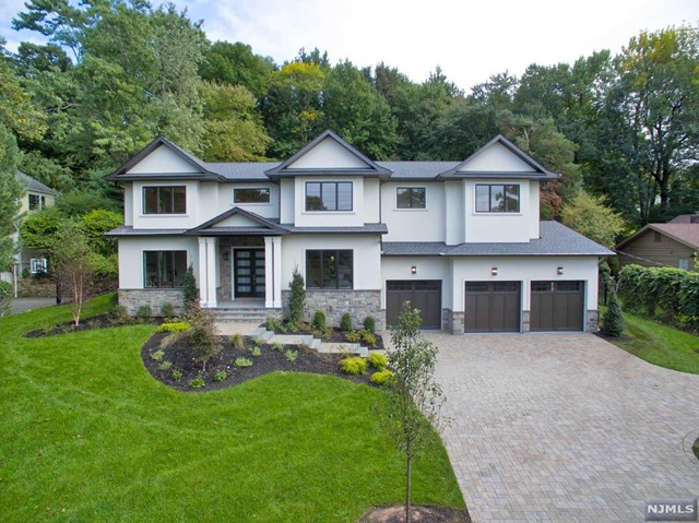 Tenafly E.  Hill New Construction. Central Hall Colonial with 6 Bedrooms and 6.5 bathrooms situated on 0.51 Acre . Expected completion Summer  2018.  The first floor consists of 2 story Entrance Foyer open to formal Living Room & Formal Dining Room leading to huge Modern Eat-In Kitchen with top of the line appliances, pantry room, butler pantry, over-sized island open to spacious 2 stories Great Room overlooking private backyard, Full Bath and Bedroom/Office on the first floor. A huge Mudroom connected to a 3 car garage. 2nd floor consists Master Bedroom Suite with his/hers Walk-in closets, 3 Bedroom suites, Laundry Room and Linen Closet. Lower level has a Bedroom,rec rm , gym, fb,Media rm . >>> POOL IS  INCLUDED IN PRICE<<<