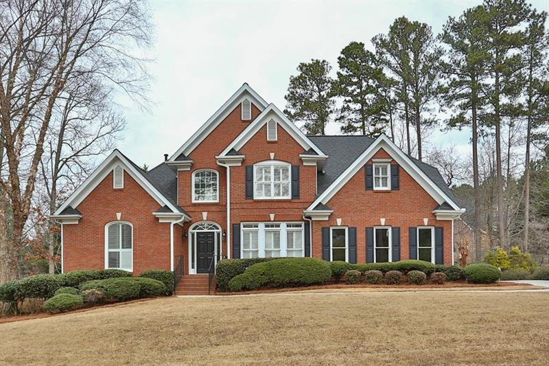 Hurry! Gorgeous traditional in Suwanee's Barony neighborhood! Light and bright kitchen features brand new stainless steel appliances, granite counters, large pantry, island, and breakfast area. Formal dining room is perfect for entertaining. Natural light pours into family room with soaring ceiling and cozy gas fireplace. Private study is ideal for home office. Main level master suite includes a trey ceiling, dual closets, and spa-like bathroom with dual vanities, jetted tub, and separate shower. Additional bedrooms are well-sized and bright with attached bathrooms! New paint and flooring throughout! Finished basement offers additional living and lounging space with extra storage. Large deck perfect for outdoor entertaining. Wonderful location close to Suwanee Town Center, Suwanee Greenway, and Sims Lake Park! Top schools include Level Creek Elementary, North Gwinnett Middle, and North Gwinnett High!