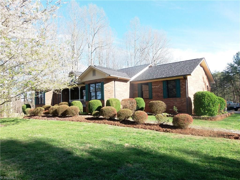 GREAT REDUCTION IN PRICE!!!!!!Custom built Brick home on 1.59 acres ( additional acreage available).Paved drive and concrete patio 2 car garage off living area and 1 basement garage. 3 bedroom 2 bath with open concept living area. Rock fireplace with gas logs, Eat in kitchen ,Formal Dining. Large master with master bath . Main Floor laundry.Full basement with large playroom and a full bath.Great home.