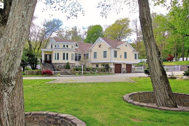 "Saugatuck Shores. Unique remodel,quality finishes. Charming atrium for grand piano & entertaining, formal DR w marina view, open flow floor plan of cozy family area w fireplace, family dining & beautifully appointed kitchen, granite, stainless steel, 2 dishwashers, wine cooler, 6 burner stove.  Brazilian Cherry floors, family bedrooms each with their own bath, luxurious master suite w fireplace, large en suite, jacuzzi & steam shower, wet bar, walk-in closet. Impeccably landscaped w waterfall, fish pond, patio, stone pavers, reading nook, privacy. Stunning (legal) ""in-law"" or guest apartment w fireplace & large rooms that flow to outside terrace. Potential 5 bedroom, close to beach, golf, boating, minutes to train. A home with personality!"