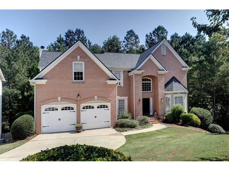 """Spacious, well-maintained home on quiet street in Georgetown Park 1 mile from Historic Downtown Norcross! Eat-in kitchen has view of backyard greenery & opens to comfy family rm w/woodburning f'place. 2nd living rm feat """"tree top"""" two-story solarium! Master ste has sitting/nursery area, gas f'place, walk-in closet, & sleek master bath feat Italian tile, dual vanities & frameless glass shower. Terrace lvl offers plush carpet, 2 full bedrooms & full bathrm, & wet bar, ideal for entertaining!  Don't miss this home offering privacy with the convenience of a great location!"""