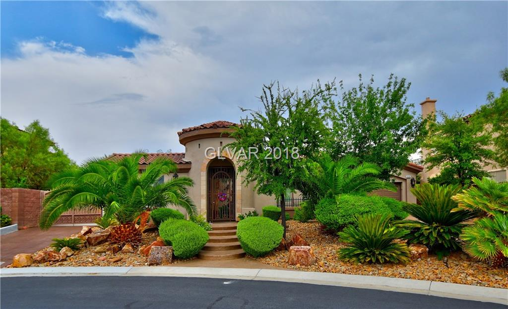 Absolutely gorgeous rare find in Mtn's Edge! Over 1/3 acre private lot (Largest in subdivision) in gated community with boat/trailer parking, sparkling custom pool AND huge detached casita (only 1 in community). Backyard paradise w/palapa, built-in BBQ and built-in bar.  Hardwood floors (2014), custom iron front door, granite counters, venetian plaster walls, upgraded cabinetry, surround sound, master suite w/jacuzzi tub, dual showerheads & more!
