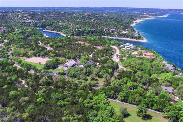 Bring your horses home to this 30 acre equestrian and recreational retreat on Lake Travis! The property includes full-sized bball & tennis courts, hiking & riding trails. 4-stall, 2,025 sq ft horse barn, that also has a very large climate-controlled common room and side kitchen. There is a detached garage with tack room and 3Br, 1Bath guest apt. Multiple fenced pastures along with a lighted riding arena. Direct waterfront access available for boat slip.