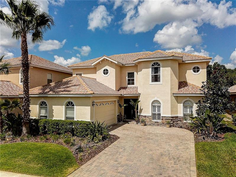 """It's all about lifestyle here at Cory Lake Isles, recently named Tampa's most popular neighborhood.  Cory Lake Isles is New Tampa's premier gated community, built around a 165-acre ski lake and The Beach Club community clubhouse.  Driving in you will notice that this community is head and shoulders above all the rest, with brick paver roads and palm tree-lined streets that instantly greet you with a tropical resort feel.  Launch your boat for a day of fishing or skiing, then stop back at the Beach Club and cool off at the resort style community pool complete with water park style water slide. If staying dry is more to your taste, there are tennis, basketball and sand volleyball courts and a roller hockey rink, or you can bike or run a 5k around the lake. Convenient to shopping, restaurants and all that makes New Tampa a great place to live.  Imagine living the perfect Florida lifestyle in your new home that features an open concept floor plan with soaring ceilings, and decorative arches and columns. Your new kitchen has 42"""" maple cabinets, roped crown molding, wine rack, and so much more! Your master suite features his and her vanities with a Jacuzzi tub and separate shower. An upstairs that has 3 bedrooms, 2 baths, and a bonus/media room. Now imagine starting your day with coffee and the paper, or ending your day with a glass of wine, sitting on your back lanai relaxing to the peaceful environment of your waterfront home and conservation view. This is the lifestyle people dream of. Make it your reality."""