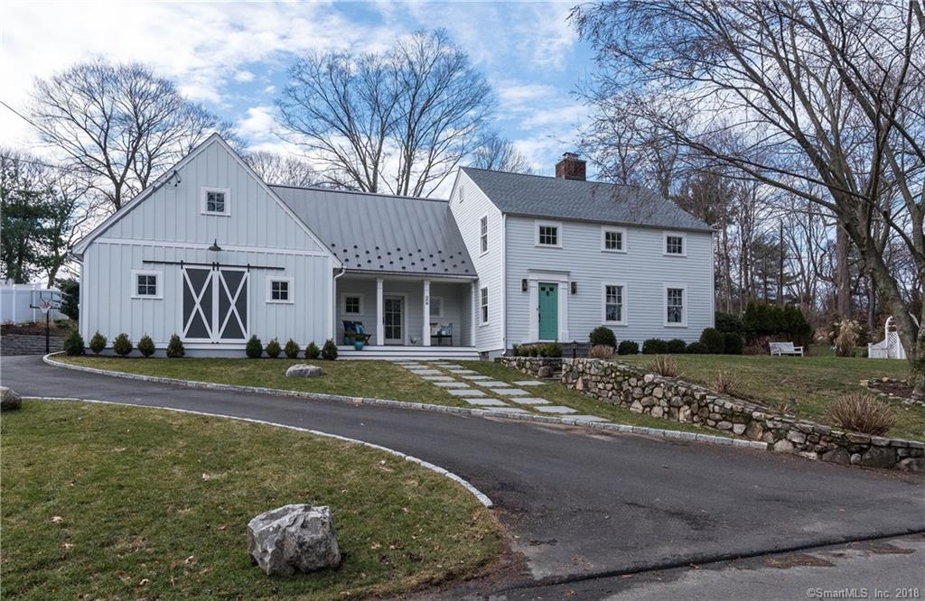 Rare opportunity: modern farmhouse colonial featuring a newly constructed in-law suite with no stairs. Crafted to the highest standards, it includes a living room with kitchenette, cathedral-ceiling bedroom, full bath & large closet. The versatile space could also be used as a luxurious first-floor master, or an au pair/guest suite. Renovations with emphasis on accessibility and low maintenance include spacious mud & laundry rooms, 3-car garage, new siding, roof, 4 zone HVAC and windows throughout. There are 3 more bedrooms upstairs, with the option of adding a new master suite in the large, unfinished space. A generous first-floor layout completes this special home, sited on a quiet cul-de-sac close to town, train & nature preserve.