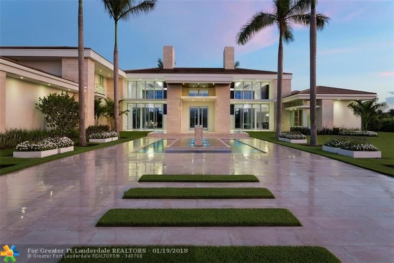 """This magnificent contemporary masterpiece is sure to impress the most discriminating buyer.  This estate boasts over 11,400 sf of conditioned space and over 15,400 sf of total area.  With 6 bedrooms 6 and 2 1/2 baths and room for a guest house, there is plenty of space for every family. Landmark Ranch Estates is known as the preeminent, multi-acre privately gated residential community in South Florida. 20 minutes from """"everywhere"""", the town of SW Ranches is known as THE affluent Beverly Hills of the East."""