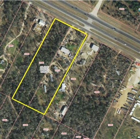 Property includes commercial building with automotive shop tenant, leased 3 bedroom frame house, and 3 leased mobile homes.  Includes billboard lease at $4,720 annually.  Approximately 20 minute drive from ABIA.
