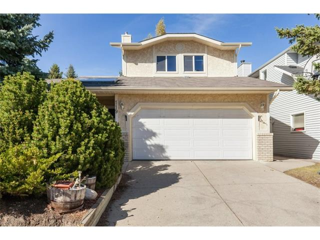 OH: SAT (Oct 14) 1pm To 3:30pm Welcome to Professionally Measured (Floor Plan Attached) 119 Hawkford Crescent NW! Situated in the prestigious lands of HAWKWOOD, one of Calgary's most sought-after communities. This 2 Stry Fully Finished family home W/ TOTAL LIVING SPACE of 2800 SqFT Plus is located on quiet street LARGE CORNER LOT & SHELTERED W/ BEAUTIFUL TREES & secluded & secure. The Home invites you W/ a large living room &  flows naturally into an always-ready formal dining room. The chef-ready kitchen features traditional oak cabinets & spill-proof tile floor. Great Comfy Family room on main floor W/ built-in cabinets & always-popular cozy warm fireplace for those cold Calgary winters. The upper floor offers total 3 spacious BR & 2 Full WR, including a large Master BR with ensuite WR  Fully finished basement has additional BR, HUGE Rec room W/ BAR & full WR for your convenience. The home is located close to reputed schools of NW, transportation, & recreation. Motivated Seller..Call your realtor Now.!!