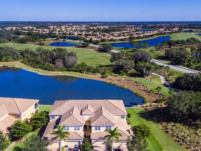 MAINT. FREE COACH HOME-GATED GOLF & COUNTRY CLUB!  This residence is situated on an end location w/out any neighbors above!  A gated courtyard at ground level presents a beveled glass front door to the foyer, attached 2+CG & storage.  A few steps up & you are on the main level overlooking the lake & 1st tee of the golf course.  Diagonal tile & carpet in bedrooms.  Kitch. w/ bkfst nook, granite, blfst bar, wood cabinets, tile backsplash, task & recessed ltg.  SS appls. included.  Mbr w/lake & golf views, together w/ dbl walk-ins.  Dual sinks, wood cabinets, solid surfaces, a water closet, a soaking tub & a sep shower can be found in the MBa.  Multiple sets of SGD access the covered & screened lanai.  Enjoying a quintessential FL lifestyle couldn't be easier in the 'worry free', gated comm of Heritage Harbour's River Strand. The assoc fees include your lawn maint. & the privilege of many country club amenities including a 27-hole championship golf, a 39,000 SF clubhouse w/ dining & entertainment options, a huge health & fitness ctr, a resort-style pool & 8 Har-Tru tennis courts. Nearby an area known as Central Park, links the communities of Heritage Harbour w/ soccer fields, baseball fields, trails, playground, picnic area & the 70-Acre Beacon Lake w/ a fishing pier. Prime river-front location on more than 2,500 acres near excellent shopping, dining, beaches, historic Downtown Bradenton & I-75, providing an easy travel north or south to Tampa, St Pete, LWR & SRQ!