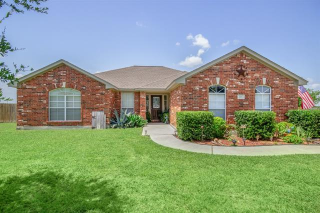 This 3 bedroom home is Hutto is ready for a new owner! It backs to an open field with no neighbors behind. Enjoy the above ground swimming pool with nice decking already in place. Inside features wood flooring, a brick fireplace with wood mantle and bay window in the breakfast area. Beautiful pantry door in kitchen! Master bedroom has trey ceiling, separate shower and jetted tub. You'll enjoy entertaining family and friends here!