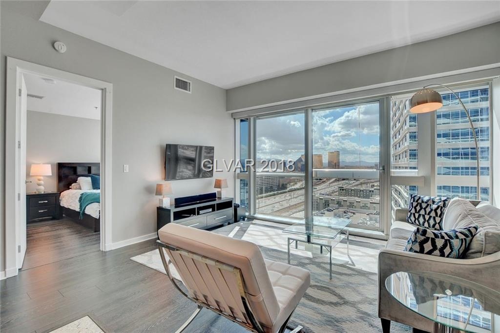 GORGEOUS 2 BR/2 BATH CONDO AT THE HIGHLY SOUGHT AFTER MARTIN HIGH RISE. FULLY DESIGNER FURNISHED & APPOINTED. MODERN KITCHEN->KASHMIRE GRANITE COUNTERS & FLOORS, STAINLESS APPLIANCES, CARRERA MARBLE CLAD BATHS, FLOOR TO CEILING GLASS. BEST OF ALL ARE THE DAZZLING LAS VEGAS STRIP & MOUNTAIN VIEWS FROM THE 18TH FLOOR & THE EVER CHANGING DESERT SKY. AMENITIES GALORE:POOL/SPA/VALET/COFFEE BAR/GYM/LIMO & MORE! *LOWEST PRICE 2 BR ON DOUBLE DIGIT FLOOR*