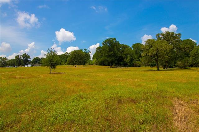 Hidden in the rolling hills of Bastrop county, just 6 miles south of Bastrop Texas lies 20+ acres with Breathtaking views and plenty of mature trees. Paved road to the property. Gorgeous location for your homesite under scattered trees and overlooking pond, currently has a 2014 mobile home!  100% fenced and agricultural exempt.  2 ponds on the property were formally stocked. Beautiful sunsets and wide open skies!