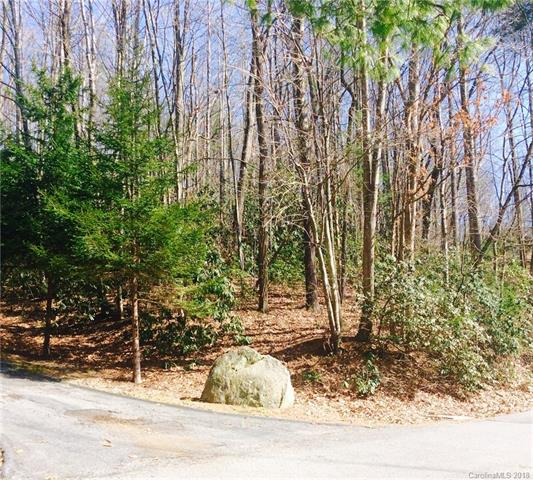BUILD YOUR DREAM MOUNTAIN HOME. GREAT LOT IN A QUAINT NEIGHBORHOOD WITH NICE VIEWS OF LAKE. IMAGINE SITTING ON YOUR DECK WITH THE SOUNDS OF THE WATERFALL WHERE POND AND LAKE JOIN IN THE PEACEFUL SETTING OF KINDY FOREST. LESS THAN 15 MINUTES FROM DOWNTOWN HENDERSONVILLE, SHOPPING, DINING AND ENTERTAINMENT.