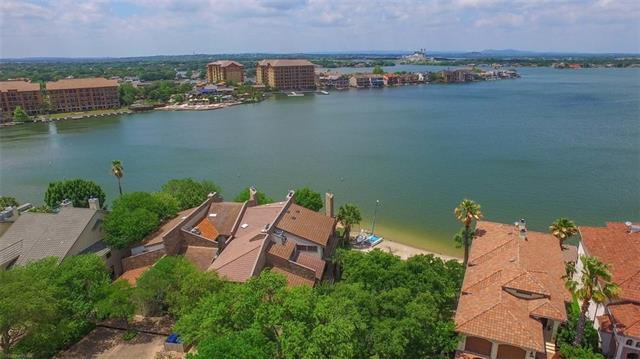 Exceptional waterfront townhome with open water views of Lake LBJ in the heart of Horseshoe Bay.  Offering open living, galley kitchen, spacious dining, wet bar, and two fireplaces. The upstairs lakeside master suite features a sitting area and private balcony, dual sinks, sauna, and walk-in closet. This townhome offers you the best of everything including location, decks, panoramic lake views, and the convenience of your own private day dock.