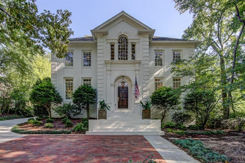 Stunning meticulously renovated home on quiet & prestigious Buckhead street. Completely updated, new master bath, freshly painted throughout, new designer light fixtures, new carpet, newly landscaped. Perfect open floorplan for entertaining and family living. Sits above street with vistas of one of Bkhd's prettiest neighborhoods. Perfect kitchen opens to bkfast rm, fam rm w/vaulted clg & FRPL & screen porch w/FRPL. Separate carriage/nanny suite above garage.