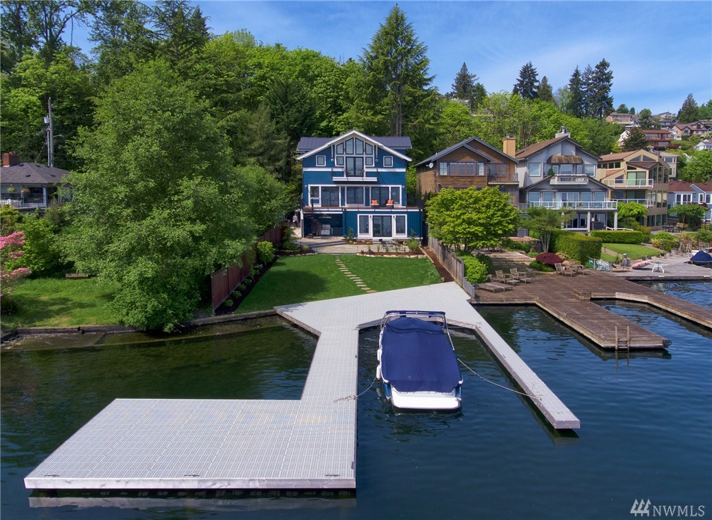 "Stunning new construction NW Contemporary home on 45 ft prime waterfront. Grand entry w/ vaulted ceilings, main floor guest suite, chef's gourmet kit w/ marble ctrs, top-end appls, custom cabts, frml dining w/ built in wet bar, huge lvng rm opens to entertainment size deck, & 4"" hrdwd qtr sawn flrs. Lavish master suite w/ marble bath, walk-in closets, 2 addtl bdrms, full bth, & 2nd laundry. Lower level has media rm, wine cellar, exercise rm, great rm, tons of storage. Stylish & sophisticated!"