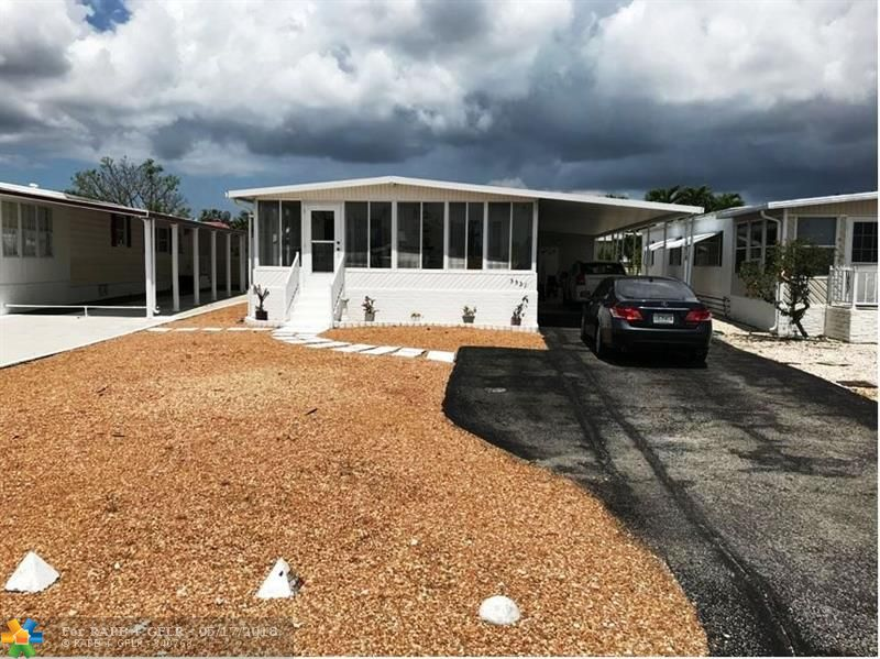 Beautiful 2/2 doublewide with carport - shed - -enclosed patio (which is glassed in) - - on oversized lot - - mostly furnished  - -huge master bedroom - -super clean throughout - - and ready to move in - -snack bar in kitchen - - priced right for quick sale - -truly a must see..........