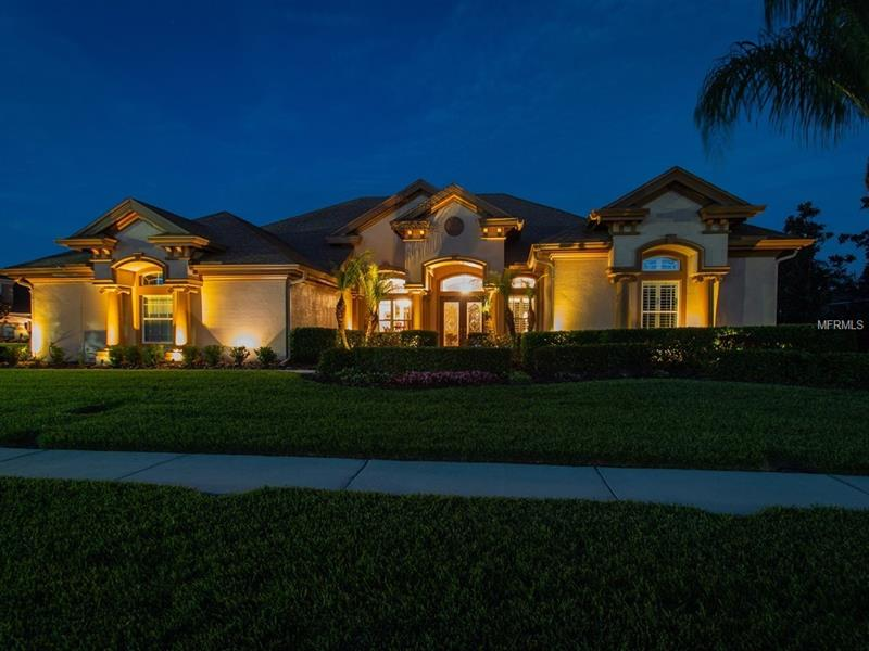 """Presenting this beautiful 2 story 3716 sq ft home w/4 BR,study, conservatory, 4 BA, 2nd FL bonus room,3 car side load garage, Eloquent custom salt water pool/spa w/outdoor Kitchen on a corner lot in the gated community of Copper Ridge/Seven Oaks. Pride of ownership is apparent as soon as you pull up to this home with its lush landscaping and outdoor lighting. Walking in you will notice the archways,decorative columns  & crown molding throughout. Gourmet Kitchen w/granite counters,42""""cabinets,built-in Double oven, microwave, wine cooler, center island, built-in desk, breakfast bar & recessed lighting overlooking the large family room. Master suite with double tray-crown ceiling,walk-in closet, garden tub,separate shower,double vanity & granite counters.The Conservatory has two walls of windows overlooking the beautiful Pool and is adjacent to a bedroom and bathroom which could be used as an in-law retreat. Large secondary bedrooms,2nd floor bonus room w/full bath and storage closet. The outdoor living space is amazing-Pool/Spa completely automated & heated; the outdoor kitchen is built w/travertine and quartz,(extensive pool features list,will be provided upon request) Plantation shutters on most windows, Hardwood floors,18"""" tile, berber carpet, ceiling fans,alarm system, outdoor camera monitoring,New A/C. Seven Oaks clubhouse has a resort pool,water slide, fitness center,tennis courts, sand volleyball & playgrounds. Close to I-75,FL Hospital Wesley Chapel, shopping,restaurants,entertainment & much more."""