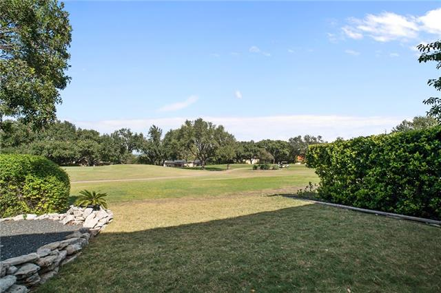 Stunning views from 3/3 remodeled townhouse located on the Live Oak Golf Course; walking distance to clubhouse, 1st Tee Box, and tennis courts. It's perfect for entertaining with a large living area, kitchen and multiple unique outdoor spaces that includes two outdoor covered patios (built-ins included). The panoramic windows beautifully frame the breath-taking views of golf course and allow an abundance of natural light into the home. Master on main floor. Lake Travis ISD. Near new Oaks Shopping Ctr.
