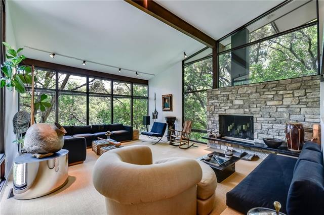 This beautifully designed Central Austin home was featured on the 2009 AIA tour of mid-century modern homes. Owned by the same family since it was built in 1961, it has been well maintained and was updated in 1993. Features include vaulted ceilings, tall glass windows and great light, all which allow you to take in the beauty of the large private wooded back yard. Move-in ready with room to expand if needed. Bright Leaf Preserve sits across the street.