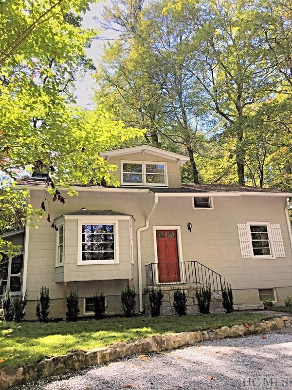 A Classic Highlands Summer Cottage with large footprint inside and out.    Highly sought-after Mirror Lake is a dream location close to it all, and is a mecca for canoeists, kayakers, fly fishers, hikers, dog-walkers, mountain-bikers, shoppers, diners, and the like.  The property itself has three floors of space, the upper two floors are 100% knotty pine throughout so you'll know you've arrived in your mountain-home.  High ceilings add to the ambiance, and plenty of light shines in throughout the cottage.  This 4-Bedroom layout will accommodate  your Guests, Visitors, In-Laws and Out-Laws.  Throw a party on the screened-in porch, the newly-constructed deck, and then let your senses of imagination and adventure go into overdrive all-around this incredible setting.