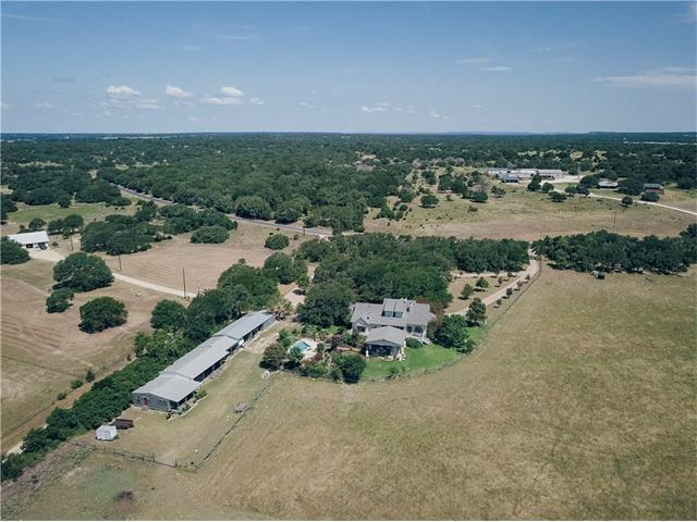 This beautiful property rolls down to Salado Creek.  A mixture of trees, pasture and stock tanks (full of bass and bluegill) provide deer, turkey and dove plenty of habitat.  The home features an open living area highlighted by a limestone fireplace and high ceilings.  The main home features 3 bedrooms, while additional living spaces are provided in a garage apartment and in a 2 bedroom guest cabin offset from the home.  An covered patio overlooks the open pastures and abuts the pool and xeriscaping.