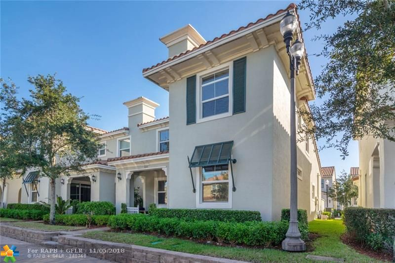YOUR HOME AWAITS IN THE HEART OF ARTESIA! Pristine 3 brm/2.5 bath town home w/ master on main floor  features second HUGE family room/playroom upstairs w/ 2 bedrooms. Kitchen features chef's island, gas stove, large dining area, Stainless appliances, tons of cabinetry! Loads of closet space and walk in laundry room! Enjoy romantic bbq in your private patio! Hurricane high impact glass, 2 car garage, 8 ft doors, large front patio for entertaining! Resort amenities w/ 3 pools, tennis, fitness,indoor multi-sport court, billiard room, tot lot w/ interactive water feature and MORE! Gated community off the Sawgrass Expressway & I-595. Walk to Sawgrass Mall and BB&T Center! Wrap this home up for the holidays! You will feel as if you are living at a resort!