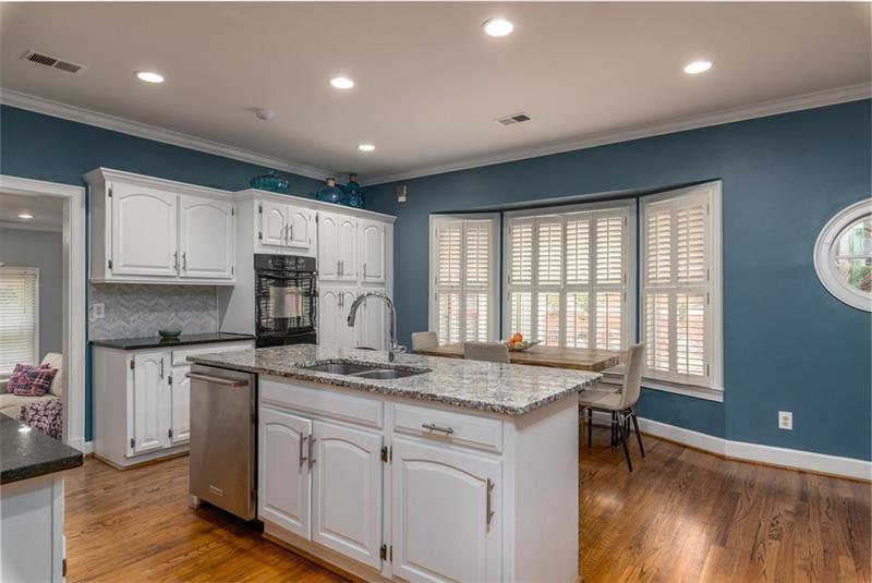 No detail left undone-granite countertops, custom backsplash, painted cabinets, plantation shutters & gleaming hardwoods!
