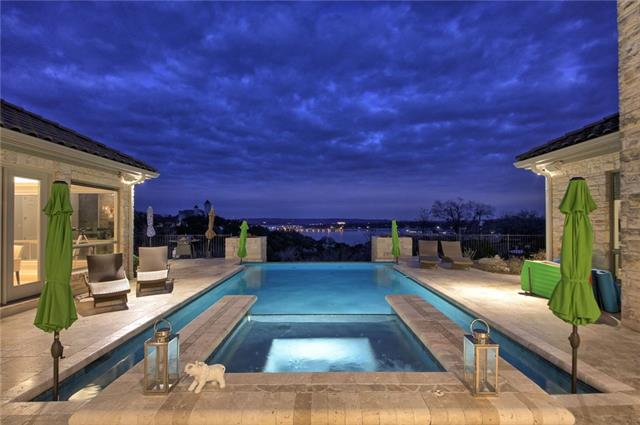 Waterfront Dream!~Lake Travis~Gated Home! Breathtaking lake views, 2+ acres, 5-car garage & sep guest house, resort-like pool. Formal foyer leads to open concept completely remodeled interiors! Spacious gourmet kitchen, wine bar, cozy fireplace, two separate offices, library/formal living, en-suite baths for each bedroom/office, grand master suite w/ fireplace. Incl. many custom-made gorgeous furnishings, 24' Cobalt Skiboat, & vac. lot in Lago Vista which grants new homeowner all Lago Vista amenities!