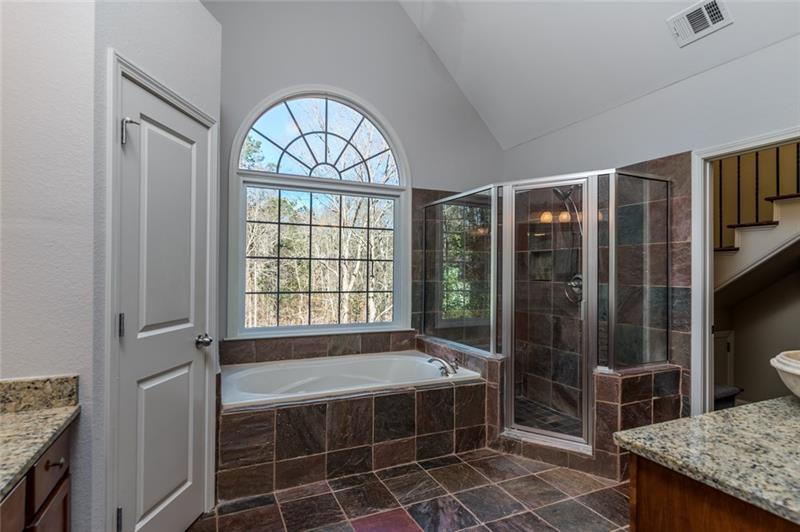 Master bath also boasts double vanities, oversized walk-in shower & relaxing jacuzzi tub!