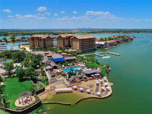 Everything your heart desires in a luxurious lake living condo on Lake LBJ! The heart of Horseshoe Bay Resort overlooking stunning open water as far as the eye can see & the fantastic amenities of the Yacht Club from the top floor, corner unit...the premier unit in The Waters. Recently renovated to exude style & luxury, the unit is being offered fully furnished. Easy access to the Yacht Club Pool, Restaurant/Bar, Marina, Resort Spa & Resort Hotel.   (Membership is required to enjoy the Resort amenities)