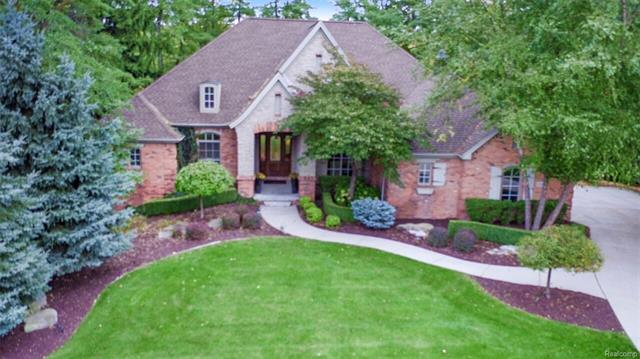"""Gorgeous custom walk out ranch. Hrdwd flrs & 12 ft ceilings. Great open flr plan for entertaining. Kit offers 10 ft long Granite island. All top of the line appli including Thermador, Jenn-air, kitchen aid. Tons of recessed & under mount lighting & electrical outlets. Custom Decora cherry cab. Charming octagon breakfast nook w/hearth room & f/p, beautiful win to view 1 acre wooded lot. Formal liv rm w/gas f/p, wall of win, Formal Din Rm w/Shonbek/ swarovski crystal chandelier. Upgraded lighting in Foyer, master, breakfast nook, din rm. Master BR w/his & hers closets, dual sinks in master bath w/jet tub & large Shower. Walk out bsmt is a """"10"""" Entertainers dream bar w/wine frig, dishwasher, ice maker, lighted glass shelving. Fam rm media area, 4th br, den/theater or office rm, Full bath w/steam shower. Hurd crank out win & doors. $50,000 worth of recent updates to improve this already custom quality home. Impeccable! Highly rated Lake Orion schools. View the list of improvements."""