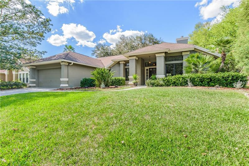 This rare find in Tampa Palms has been completely remodeled with top of the line finishes.  The open floorplan of this 3 bedroom 2.5 bath home flows perfectly onto the oversized, private screened patio.  High ceilings and fresh designer paint gives the home a bright, welcoming feel.  All flooring is brand new with luxury vinyl plank flooring throughout and Italian tile in the master and guest baths.  The kitchen boasts Shaker style, soft close cabinets that are full overlay and exquisite quartz counters.  Gorgeous backsplash, oversized single basin sink, modern faucet, recessed LEDs and Frigidaire Gallery appliances makes the kitchen and great room area the center of this fabulous home.  The large master bathroom is truly an owner's retreat.  The beautiful double vanity has quartz counters with new mirrors and faucets along with a large shower and frameless shower enclosure.  New exterior paint and mature landscaping gives this home fantastic curb appeal.  Low HOA fees, community center with pool, tennis and play area and A rated schools!  Excellent location close to USF, Moffitt Center, Florida Hospital and I-75.  Don't let this one get away.