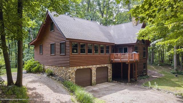 This remarkable & impeccably maintained Log Home is a beautiful mix of solid engineering & creative handcraftedness. Situated on 11 wooded & private acres, it is one of a kind for lower Michigan.  To recreate what has been completed, the cost would exceed $650,000.  What an extraordinary value! 2-story stone fireplace in the Great Room w/Extraordinaire wood burning insert. Anderson windows in every room. Covered porch & the balcony overlooking the pond & forest.  Open Kitchen w/Kraftmaid cabinetry & dining area. First floor master suite w/master bath including jetted tub & separate shower. Family room trimmed w/cherry wood. Main floor laundry with plenty of storage. 2 large bedrooms on upper level with second full bath & loft area. Bonus room provides storage. Fully finished walkout basement - high ceilings, entertainment room w/home theater projector & 7'x15' screen & surround sound. Newly finished barrier free, lower level guest suite. True up north feeling yet conveniently located.
